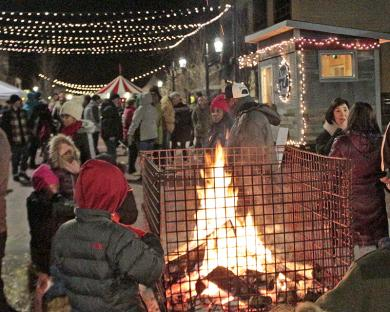 A bonfire in Martin Square attracts festivalgoers who need a little warm-up.