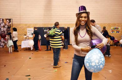 As the Noon Year's Eve party winds down in Homewood, Summer Jackson-Cole keeps the party going as she dances with her balloons.