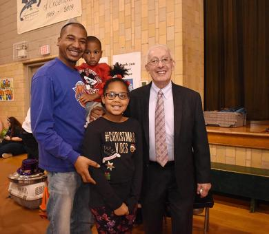 The Harrison family, father Walter, Walter Theodore,3, and Kennedy, 9, pose with Homewood Mayor Richard Hofeld as they take part in Homewood's annual New Years Eve party.
