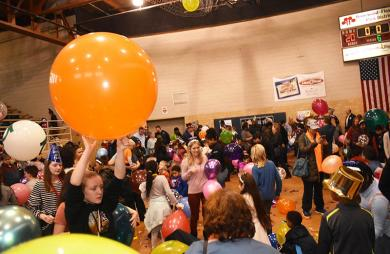 Homewood residents and guests celebrate the New Year early at the family Noon Year's Eve party at the H-F Park District Auditorium. A noon countdown was held with balloons dropping from the ceiling.