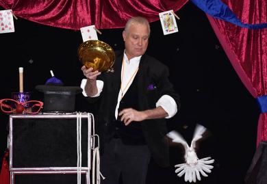 Magician Mr. D. performs a magic trick during the annual Homewood Noon Year's Eve party.