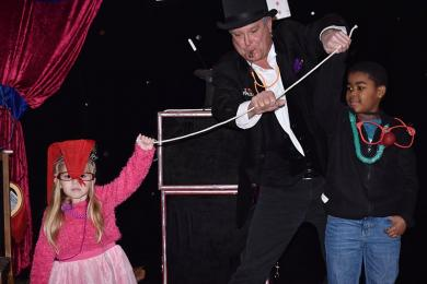 Magician Mr. D (aka Dirk Spence) does a rope trick at the Noon Year's Eve family party. Helping him are Emma Muller, 3, of Homewood and Jaden Mannin, 7, of Chicago.
