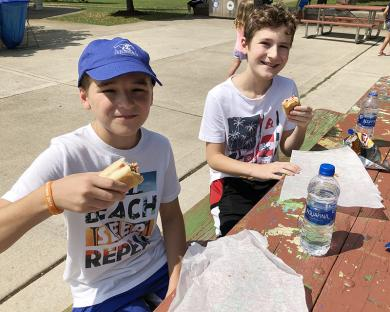 Luc and Quinn Loudon toast to Hot Dog Day.