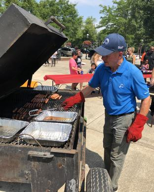 Dave Ward, superintendent at Coyote Run Golf Course, helmed the grill.