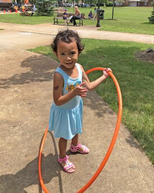 Simone Craddock, of Homewood, has fun with her hula hoop.