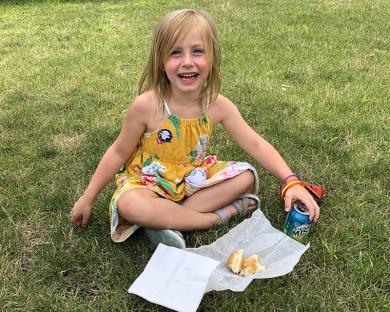 Marilyn Kruk, 5, of Homewood, enjoys her hot dog picnic-style.