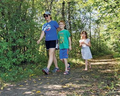 Megan Swartz of Homewood, and her two children, Louisa, 5, and Elliott, 7 ½, take a walk along the trails on Sunday, Sept. 13.