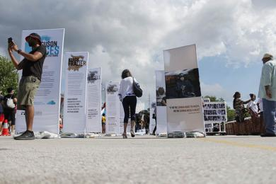Festival guests peruse the Moral Courage Project display. (EC)