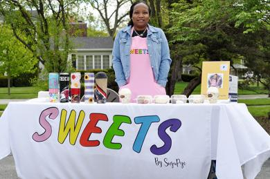 Tauria Dilworth offers customized tumblers as well as freshly baked treats at her Sweets by SugaPye table. (BJ)