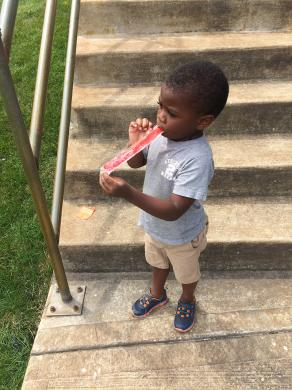 Oh, it's so good! Micah Bolton, 3, of Homewood got a special treat after he ran in the sack race at Irwin Park.