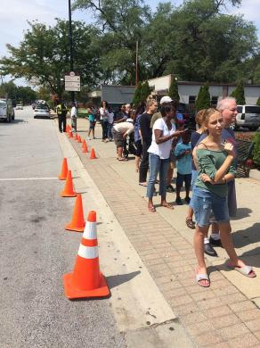 Despite the warm temperatures, people stood in line for their cool treats from Homewood's Dairy Queen.
