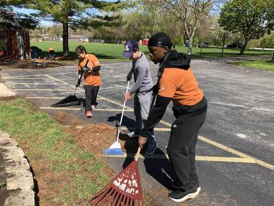 Cleaning up around a flowerbed in Lions Park on Ridge Road in Homewood are, from left, Liz Tavitas of Glenwood, Aaron Havens of Homewood and Mekhi Jackson of Sauk Village. (MT)