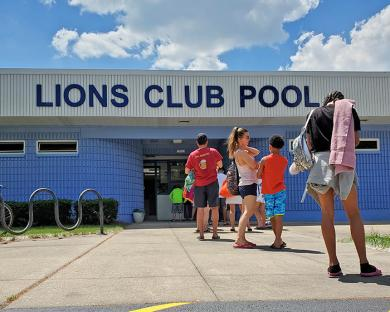 A small line of swimmers waits for Lions Pool to open on June 5. (EC)