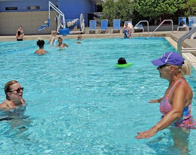 Long-time pool users Carol Decker, left, and Noreen Donadio enjoy the cool water on a hot day. (EC)