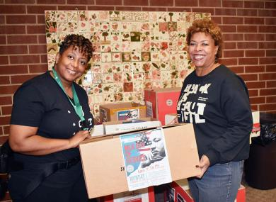Nicole Brookens, president of PLAN4SUCCESS, and Janie Davis, vice president of the organization, hold boxes of donations during MLK Day of Service at Flossmoor village hall. Brookens is also the Flossmoor events manager and led the coordination of MLK Day of Service activities in the area.