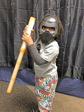 """Four-year-old Darnell Patterson III of Markham gave it his fiercest, strongest effort with his lightsaber at the Homewood Public Library's """"Star Wars"""" event as he portrays Kylo Ren, also known as Ben Solo."""