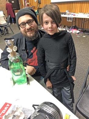 """Harmony LaBeff and his son, Zeke, a student at Serena Hills School, took time to create a droid at the Homewood Public Library's Star Wars celebration. They became Star Wars fans when """"The Force Awakens"""" series was released."""
