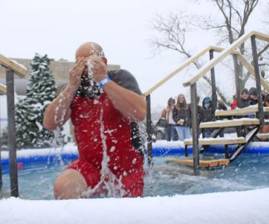 Troy O'Quinn, a member of the Homewood Community Relations Committee, comes up for air after a cold dunking.