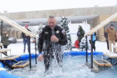 Police officer Brian Beauchamp did the dip in full uniform.