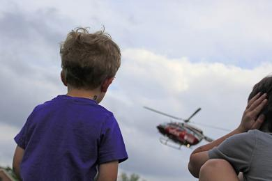 Cole, left, and Ethan Westerhoff of Homewood watch the UCAN helicopter come in for a landing.