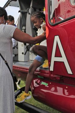 London Polk of Homewood climbs down after taking a look in the UCAN helicopter.