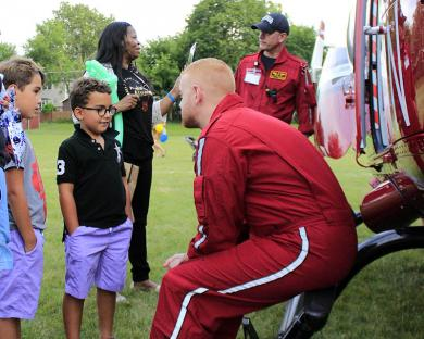 Flight physician Hani Kuttab, right, talks about his work with Max and Alex Marlo of Homewood.