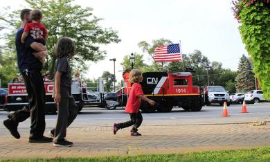 CN Railway's Lil' Obie gives rides during National Night Out in Homewood.