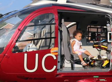 A youngster takes a seat in the UCAN helicopter at National Night Out in Homewood. (JG)