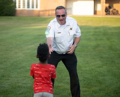 Homewood's Deputy Chief of Police Robert Misner enjoys a round of balloon toss, a National Night Out tradition. (QA)
