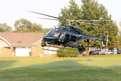 A helicopter drops by for a visit at Homewood's National Night Out. (QA)