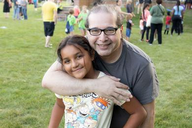 Ramses Godoy and his daughter Elizabeth Perdomo enjoy the festivities and Homewood's National Night Out. (QA)