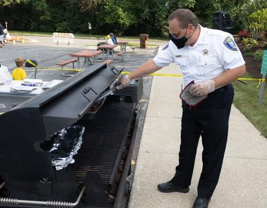 Flossmoor Police Chief Tod Kamleiter cooks up something good on the grill. (QA)