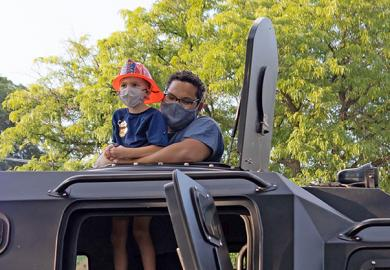 Franklin Hernadez and his nephew, Charlie Wiegand, pose on a SWAT truck. (QA)