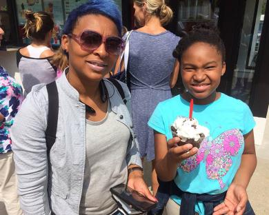 Niah Tibbs, 11, who came to Dairy Queen with her mother, Nakesha, walks away with a smile on her face and a special treat in hand.