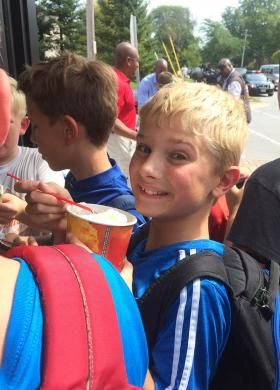 Nick Piotrowski, a sixth grader at James Hart School, is delighted with his Dairy Queen treat.
