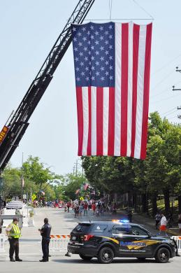 A large American flag hangs from the ladder of a Flossmoor fire truck near the intersection of Flossmoor Road and Sterling Avenue. (BJ)