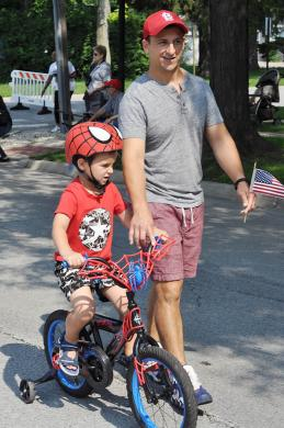 Julius, 5, and Nico Berrini, of Flossmoor, take part in the annual parade. (BJ)