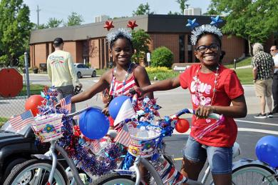 Lauren (left) and Carrington Hughes, 10 and 11 respectively, of Flossmoor, pose for a photo with the bikes they decorated with the help of their grandfather. (BJ)