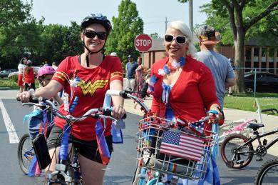 Jessica Boggs (left) and Renee Basick, of Flossmoor, show off their patriotic bikes and attire before the start of the parade. (BJ)