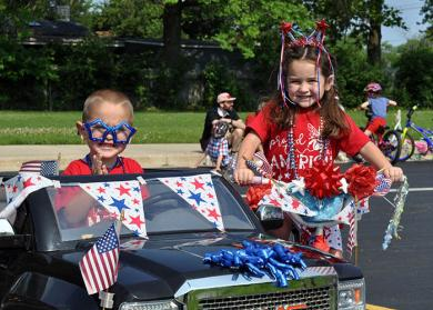 Grayson and Charlotte Levy, 4 and 5 respectively, put their patriotism on display before the start of the parade. (BJ)