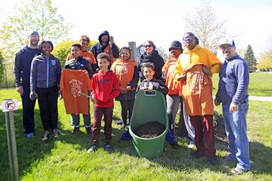 Representatives of a number of Flossmoor Baseball and Softball teams pause for a photo after finishing the clean-up of Highland Park. (EC)