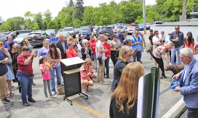 Dozens of people attend the ribbon cutting ceremony to mark the official opening of the South Suburban Humane Society's Homewood Adoption Center on Friday, June 21. (EC)