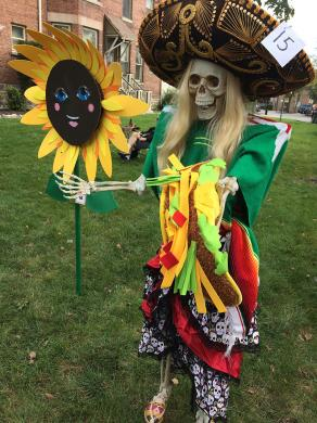 Lots of creativity was on display on Martin Avenue during the scarecrow competition including this giant sunflower by Erica Van Schiak and a Day of the Dead scarecrow from Cilantro Cocina Mexicana Restaurant.