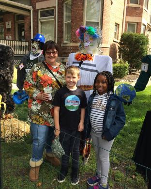 Willow School second grade teacher Mary Jo Boehm with her students Calvin Huizinga and Kailynn Robinson stand proudly at their scarecrow entry.