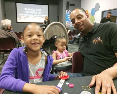 Andre Senegal of Homewood and his daughters Perri, 6, and A.J., 2, were busy attached magnets to metal. The pieces were added to an art project at the Homewood Science Center.