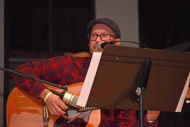 Doug Raffety sings and plays acoustic guitar at the ShowOff event on Friday evening.
