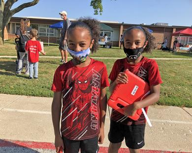 Willow School second graders Christian, left, and Christopher Green came to school to meet their teachers and get their supplies.