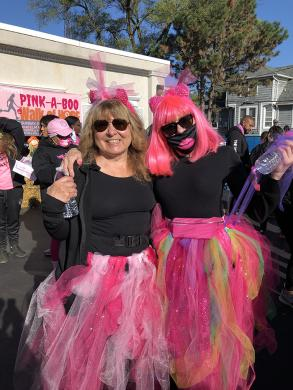 Cancer survivors Diane Kennedy and Arene Brostrof look great in pink as they start the 3K Walk of Hope. (MT)