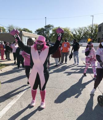 Wearing pink boxing gloves, Shatonbria Anderson, an eight-year cancer survivor, leads her team as they start on the 3K Walk of Hope Sunday, Oct. 17. (MT)