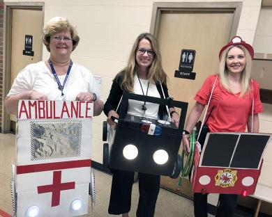 Emergency vehicles led the parade, driven by  school nurse Gail Straney, from left, principal  Melissa Lawson and assistant principal  Nancy Wood.